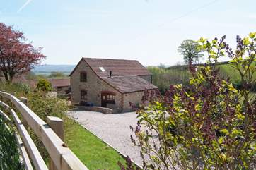 Stable Tallet is a beautiful barn conversion to one side of the historic farmstead here, in its own gardens and with its own driveway.