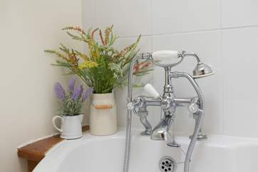 The bath has a useful shower attachment - there are two other showers in the property too of course.