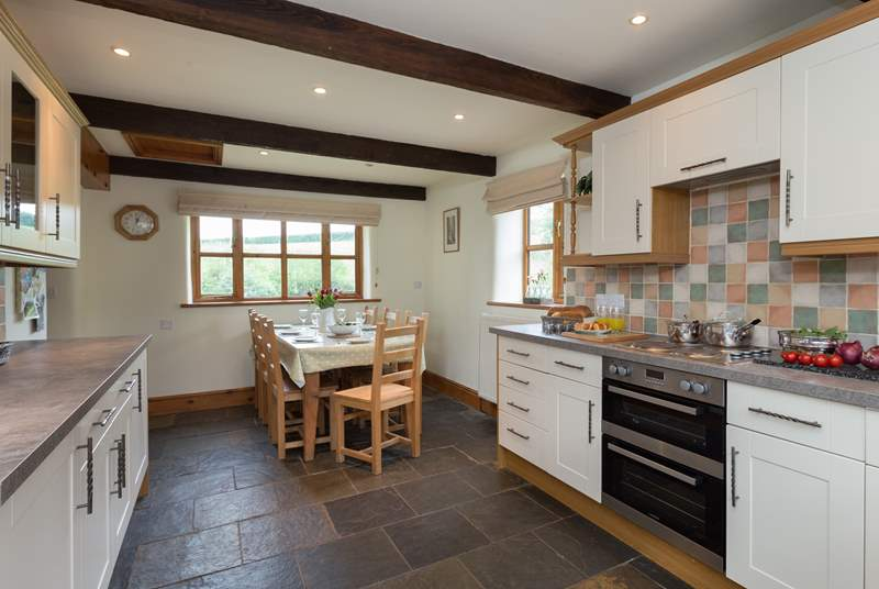 Tthe farmhouse-style kitchen has flagstone floors and is equipped as a home-from-home.