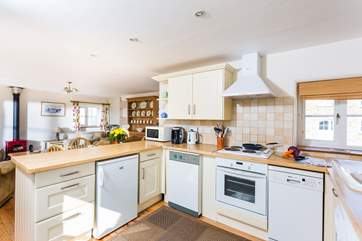 The well-equipped kitchen is open plan.