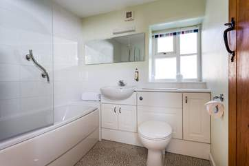 The bathroom is down the corridor between the bedrooms and living-room.