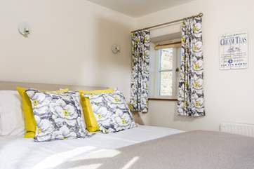 The cottage has been furnished with beautiful fabrics.