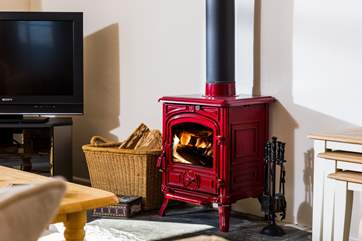 A lovely red wood-burner to keep you cosy on those cooler days and evenings.