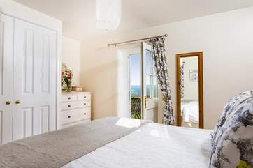 The double bedroom has a door opening onto the raised decked balcony.