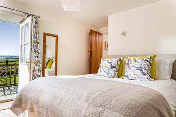 The double bedroom is located at the opposite end of the cottage to the living-room.