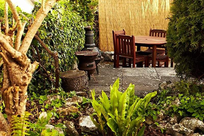 A lovely little spot for al fresco dining in this sun-trap.