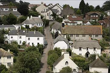 Holcombe village. The cottage is on the left halfway up the hill (with cars parked outside).