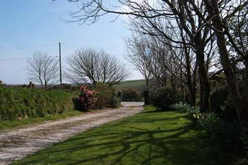 The driveway and surrounding countryside.