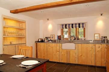 The kitchen units, with granite worktops, are beautifully constructed from reclaimed timber.
