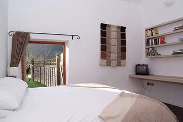This is the ground floor bedroom with its king-sized bed and doors directly out to the garden,