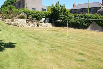 The large garden is just 10 yards from Pebble Cottage and has a badminton/volleyball net for fun and games.