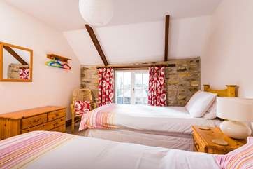 A comfy room for adults or children, with views over the courtyard.