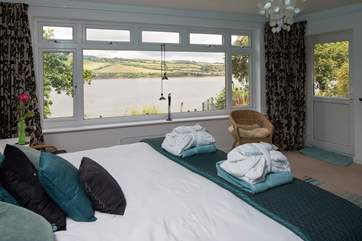You can lie in bed and look up the river in Bedroom 2.