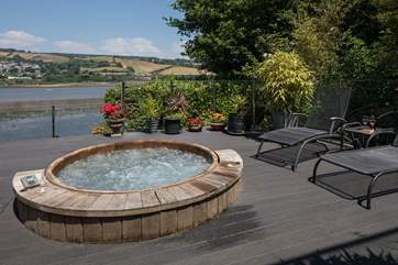 The fabulous sunken hot tub treats you to some of the most fantastic views over the water.