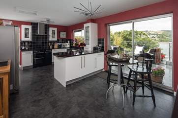 The open plan feel of the kitchen/diner is complimented by the patio doors which lead straight onto the decking and hot tub area.