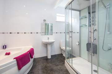 The family bathroom on the lower level has this superb corner bath and power shower.