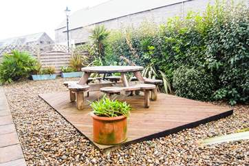 The decked and gravelled garden outside Lock House.