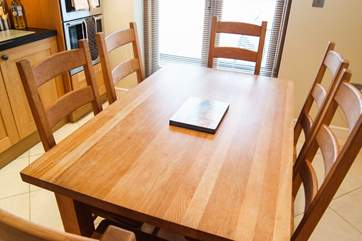 A spacious oak dining-table for relaxed holiday meals.