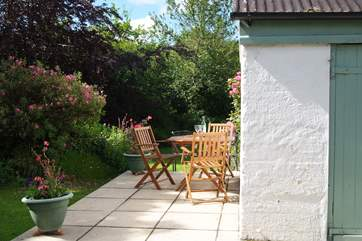 There is a lovely spot to sit on the patio beside the games-room with views over the garden.