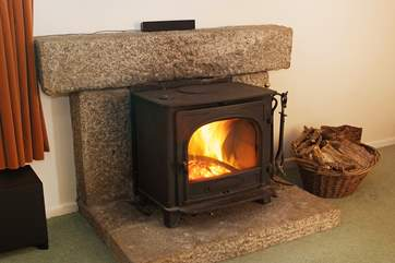 The warming wood-burner will keep you cosy on those cooler evenings.