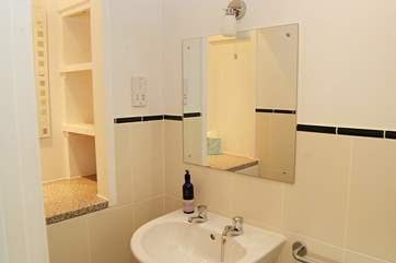 The en suite cloakroom with wash-basin and WC for convenience.