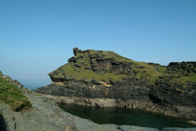 Boscastle's dog-leg harbour leads out to the open sea.