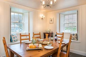 The dining-room enjoys views back to the village and down towards the harbour.