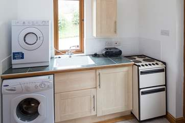 The spacious utility-room has all the appliances that you will need.