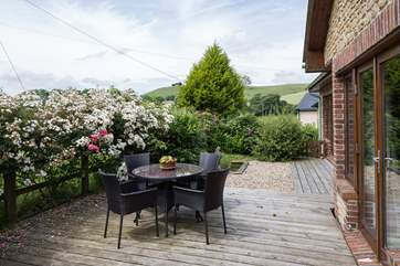 The lovely sheltered terrace has unspoilt countryside views, perfect for al fresco dining.