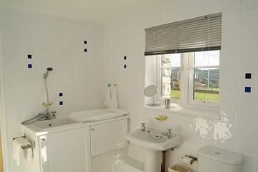 The en suite bathroom has a purpose-built baby bath and shower unit.