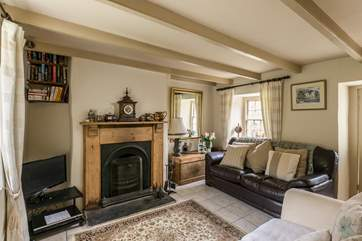 The sitting-room has an open fire which makes Filkins Cottage a great place to stay all year round.