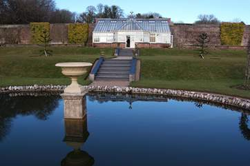 Inland, visit the National Trust estate at Arlington, lovely gardens, historic house, carriage museum and tea shop.