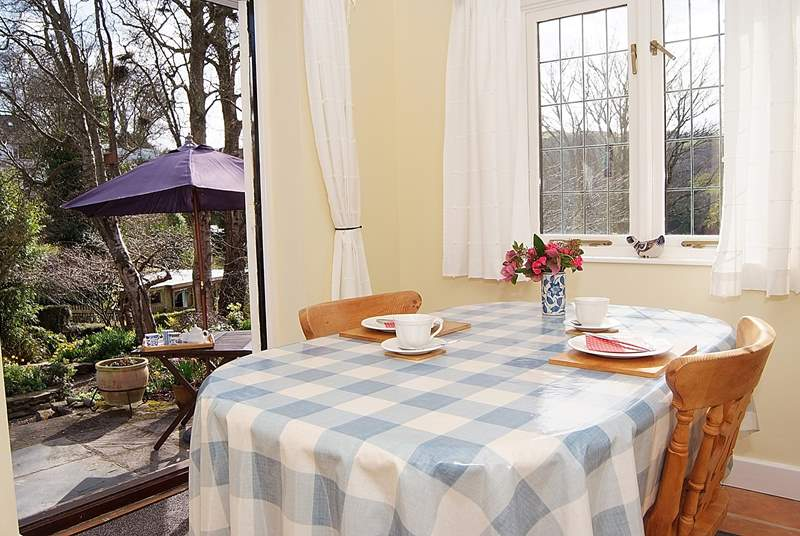 With windows on two sides and French windows to the garden, the dining-room is a bright and sunny room.