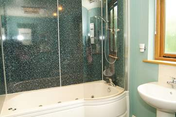 The bathroom with whirlpool bath.