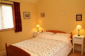 The comfortable double bedroom with en suite shower-room.