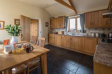 Inside, the spacious and well-equipped kitchen is light and airy.