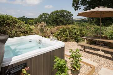 Take a soak in the hot tub after a day exploring the countryside - enjoying those fabulous countryside views.