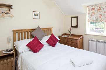 The en suite bedroom, bedroom 2 has views over the village to the countryside beyond.