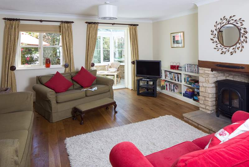 This cheerful room opens out into the conservatory, the wood-burner effect electric fire gives a cosy feel in winter. Lots of games and DVD's so that all the family can join in.
