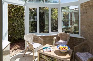 The pretty conservatory is a great place to relax with morning coffee or an evening glass of wine.