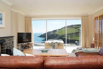 Huge picture windows in the main sitting-room take in the wonderful views.