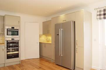 The big, fully equipped kitchen has an American-style fridge/freezer plus an additional fridge.