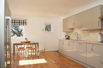 There is space for a table and chairs in the kitchen/breakfast-room.