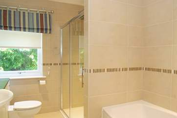 This bathroom is en suite to Bedroom 2, and has both a bath and double-size shower cubicle.