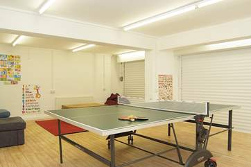 The games-room has table-tennis, games and comfy chairs.
