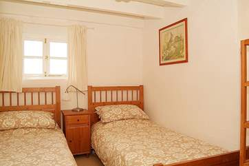 The cosy twin bedroom is also on the ground floor (Bedroom 2).