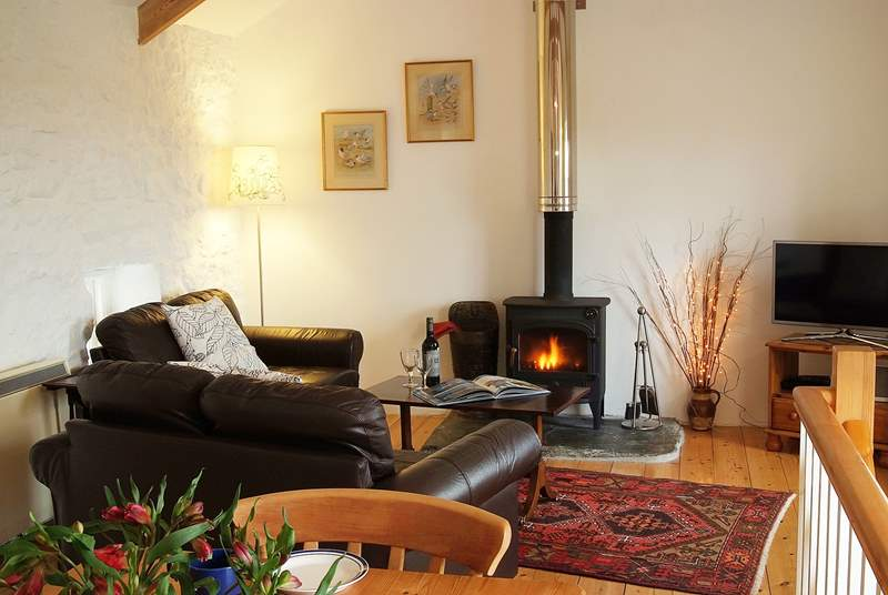Leather sofas surround the welcoming wood-burner in the sitting-area.