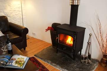 The cosy wood-burner is the perfect spot to warm your toes.