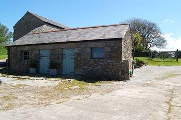 The entrance to the cottage parking with the laundry-room for Little Trebarvah in the single-storey barn on the left.