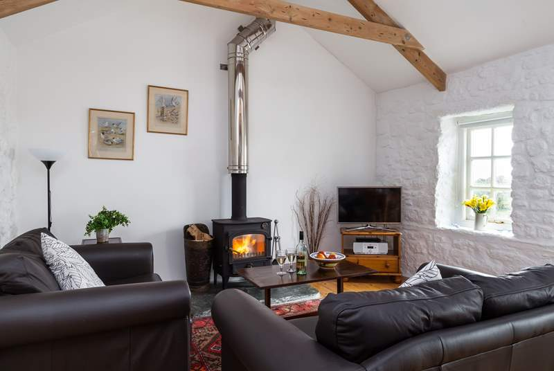 Sink into the sofas in front of the wood burner.